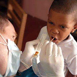 A Pediatric Dentist at Work (Image from Wikimedia Commons under the public domain)